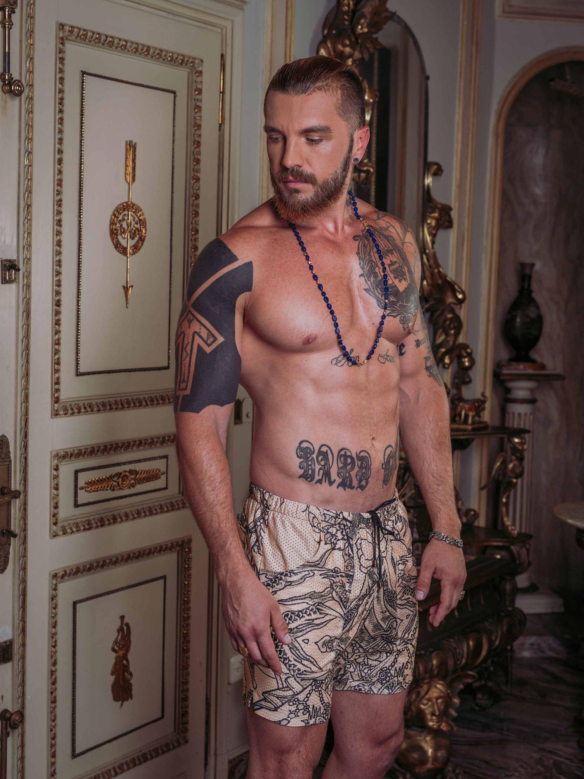 Perforated Tattoo Swim Shorts / Nude / Angle (Photo: Tom Hooliganov)